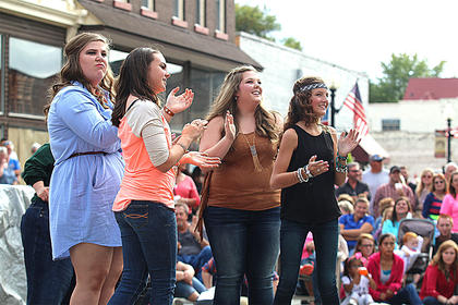 You would never know that this group of girls were competing against each other in the Ham Idol Saturday evening. Pictured are Lydia Smith, Tatum Ann Riggs, Ann Courtney Thompson and Grace Farmer dancing during the Ham Idol competition.
