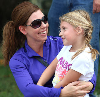 Lauren Spalding congratulates her daughter, Olivia, who was a competitor in the pedal pull competition Sunday afternoon.