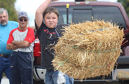 Cage Thomas watches the hay bale after his throw in the boys division on Sunday afternoon.