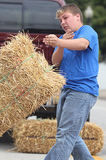 Taylor Gabhart won the boys division in the hay bale toss.