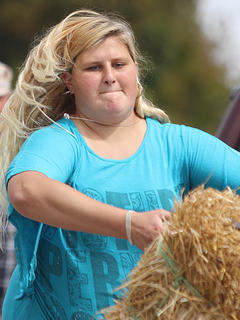 Kellie Conley makes her winning throw in the women's division of the hay bale toss.