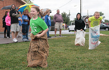 Jenna Mullins hops to a win in the 7-9-year-old sack race Saturday morning at St. Augustine.