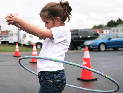 Harper Blake of Bradfordsville wins the 4-6-year-old division of the hula hoop contest on Saturday.