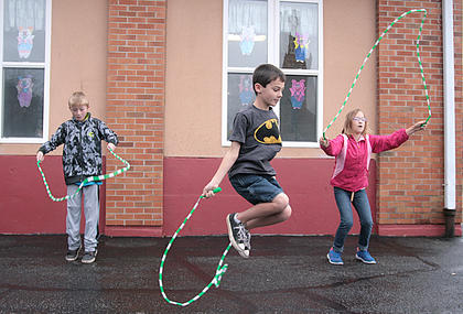 From left, Levi Brady of Lebanon, Preston Essex of Loretto and Trinity Perry in Loretto compete in the jump rope contest Saturday morning.