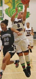 Makayla Epps goes strong to the basket against a Washington County defender in the first round of the 5th Region Tournament.