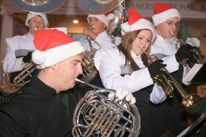 Marion County High School band members perform Christmas music outside Farmer&#039;s National Bank. Tyler Fenwick is on the French horn, Marissa Espinosa and Zachary Bray are on trumpet, andAaron Cook and Brandon Blandford are on sousaphone.