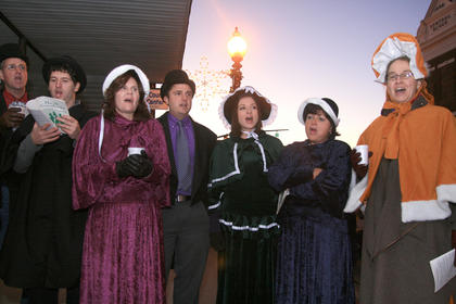 The Burdette family got in the Dickens Christmas spirit by caroling in period costume. From left, they are Pat Burdette, Chase Burdette, Martha (Burdette) Spalding, Ryan Burdette, Natalie Burdette, Debbie Burdette and Ilona Burdette.  Lewis Burdette was also singing but is not pictured here.