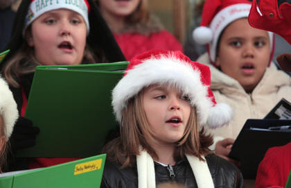 Glasscock Elementary students sing Christmas carols on the courthouse steps to kick off Dickens Christmas Nov. 26. Pictured are Kali Greene, Jasmine Patterson and Denisha Yantis.