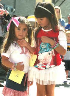 Bella Noe, left, won the best dressed girl contest during the children's parade.