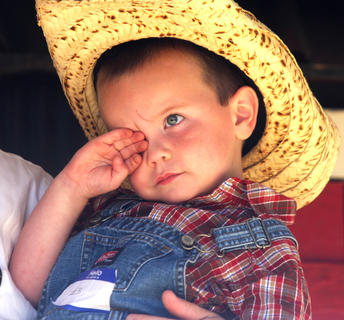 Junior Farmer participant Bryce Cecil is a little sleepy while on stage during the Junior Farmer contest Saturday morning.