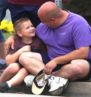 Austin Clark is congratulated by his father, Michael Clark, after competing in the pedal pull contest.