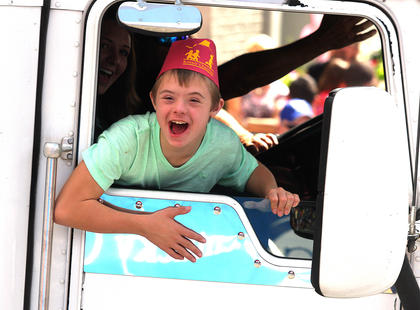 Hunter Delk shows how much fun he's having while riding in the PIGasus Parade.