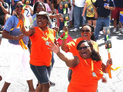 Members of the Bell family have fun with the crowd during the PIGasus Parade. They are Gwen Spalding, Dee Dee Young and April Bell Litsey.