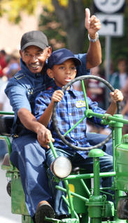 John Bell and his grandson, Micah Walker, go for a tractor ride in the Pigasus Parade.