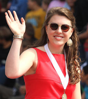 Hannah Wilson, the 2013 Marion County Distinguished Young Woman, waves to the crowd during the Pigasus Parade.