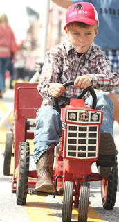 John Lincoln Perry easily won his class in the Pedal Pull contest Sunday afternoon.