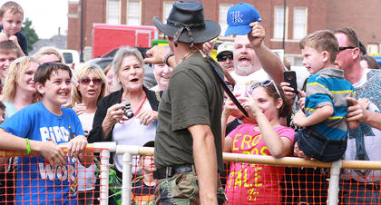 The Turtleman makes a quick trip to greet fans waiting at a fence around the David R. Hourigan Building, where he was signing autographs and posing for photos.