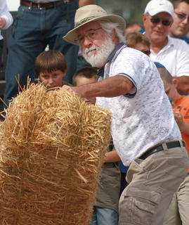 Dennis Tracy of Charlotte, NC, makes his best attempt during the hay bale toss.