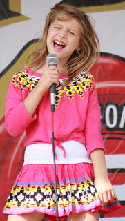 "Alexandra Baghdady, 9, of Monroe, Conn., sings ""Picture to Burn"" by Taylor Swift in the karaoke contest Sunday afternoon on the main stage."