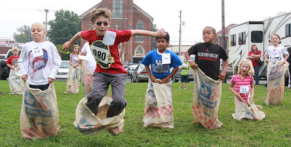 The children's games at St. Augustine included bubble gum blowing, paper airplane flying, and (pictured above) sack racing.