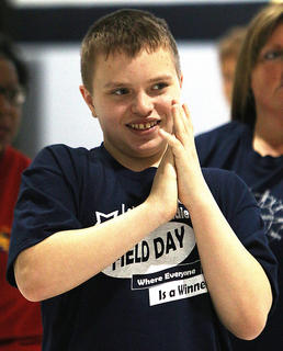 Lebanon Middle School student Jesse Orberson cheers on his teammates.