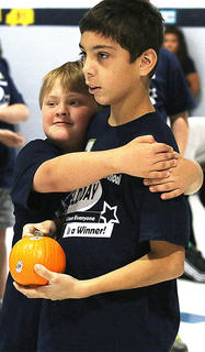 Patrick Vittitow, a student at Lebanon Elementary, shows Lebanon Middle School student Kenny Hillman some love.