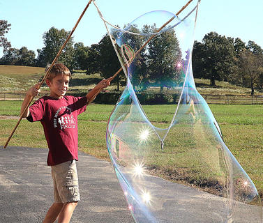4-H Science Day was held Oct. 7 at the Marion County Extension Office in Lebanon. Students, age nine to 13, took part in the 2015 National Youth Science Day Experiment, and other activities involving rockets, giant bubbles and even Madagascar hissing cockroaches. Pictured is Aiden Bickett creating a giant bubble.