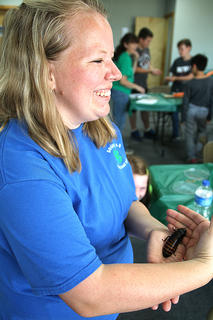 Rebecca Hill, Marion County Extension Agent for 4-H Youth Development, encourages students to hold a Madagascar hissing cockroach.