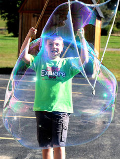 Carson Osborne creates a giant bubble.