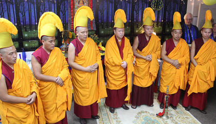 The monks chant before destroying the mandala Friday afternoon.