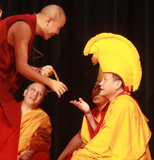 "Tenpa Phuntsok engages in a debate with Lama Kunzang Tenphel during the ""Let's Travel to Tibet"" program. Debate is one of the ways monks learn Buddhist philosophy."