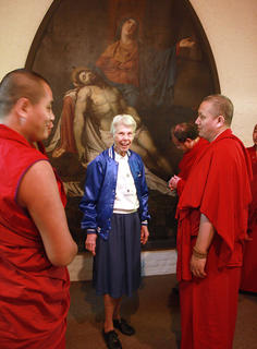 Sr. Antoinette Doyle welcomed the Buddhist monks to the Loretto Motherhouse Oct. 12. She explained that the painting in the church was painted by a Belgian painter in 1821.