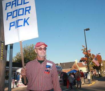 "For one day at least, Kentucky was in the spotlight during the 2012 President election. Centre College in Danville attracted visitors from all over Kentucky and even out of state for a festival to coincide with the second time the school has hosted a Vice Presidential Debate. Pictured is Skip Anderson of White Mills stood on a corner holding a sign reading ""Paul Poor Pick"" on one side and ""Go Joe"" on the other."