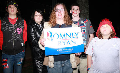 Tomi Posey of Frankfort and her family show their support for the Romney-Ryan ticket.