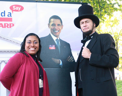 Centre College Trustee Angie McDonald-Hackett poses with an Obama cutout and an Abraham Lincoln impersonator.