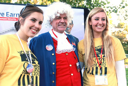 Centre students Kristin Raque (left) and Alexandra Bell pose with a George Washington impersonator.