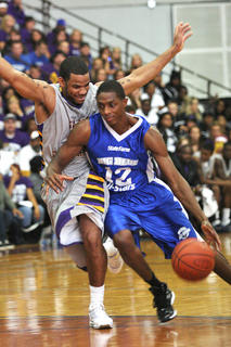 Brandon Knight passes a Saint Catharine College defender in the Big Blue All-Stars game Thursday at the Roby Dome.