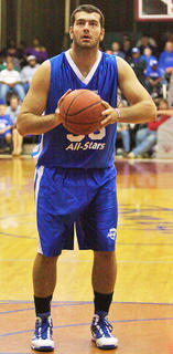 Josh Harrellson attempts a free throw in Thursday&#039;s Big Blue All-Star game.