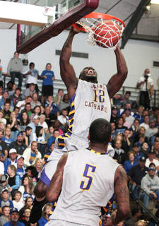 Patriots senior forward Kashiff Carr throws down a dunk against the Big Blue All-Stars.