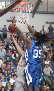Denver Nugget Kenneth Faried blocks a shot by St. Catharine senior guard Terrance Withers. It was one of Faried many blocks in the game.