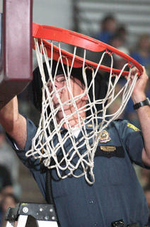 Major Greg Young, the assistant chief of the Lebanon Police Department, repairs a rim that stayed bent following a dunk.