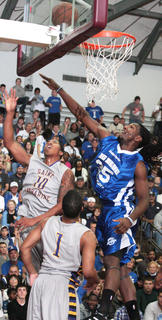 St. Catharine senior guard Brandon Johnson scores on a lay-up over Kenneth Faried of the Denver Nuggets.