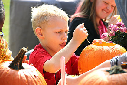 Photo by Melissa Murphy Layne Ramey concentrates as he carves a pumpkin.