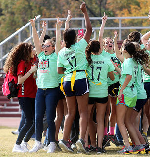 The junior powder puff team celebrates their win over the sophomores.