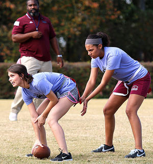Kylie Benningfield prepares to snap the ball to Kennesha Furmon.