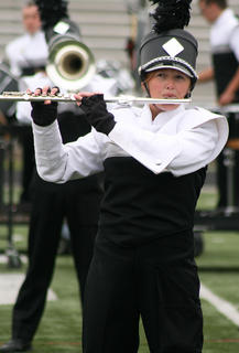 Lexy Cambron plays the flute.