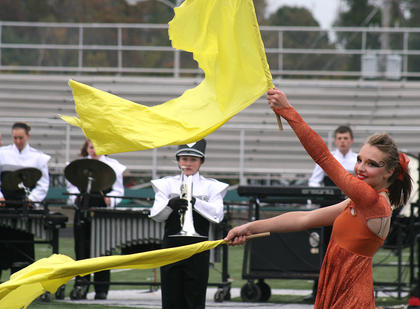 McKenna Bartley of the color guard uses her flags to add a visual flourish to accompany the music.