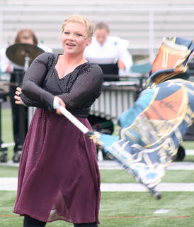 Kristina Leake is one of the featured performers in the Marching Knights' performance, switching from playing music to dancing to flag work throughout the piece.