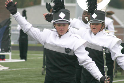 Kelsey Hamilton (left) and Allison Sallee stretch during one of the band's early movements.