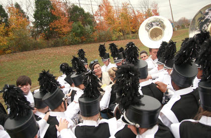 Marion County Band Director Curtis Bennett gathers the Marching Knights together for some final words of encouragement before their AAAA state semifinals performance.
